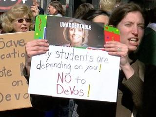 Dozens protest DeVos near Sen. Portman's office