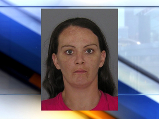 Woman charged in abuse of overdose victim's body