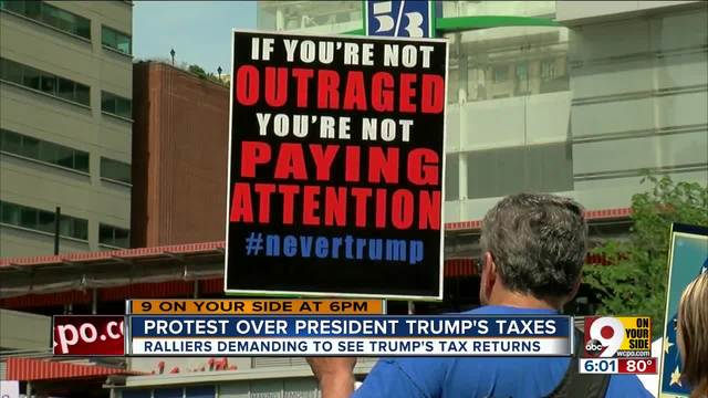 Hundreds gather for Tax Day march Downtown- demand Trump release tax information