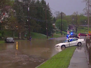 VIDEO: Crews rescue man from flooded car