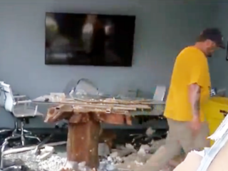 Truck crashes through wall into business meeting