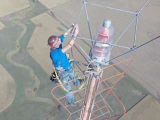 WATCH: Who changes lightbulbs atop TV towers?
