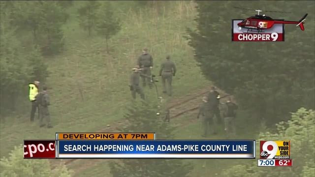 Law enforcement searching farm near Rhoden family murder site