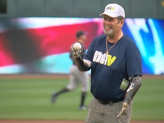 Quadruple amputee veteran throws first pitch