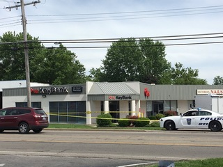 Police: Bank robber, customer shot at each other