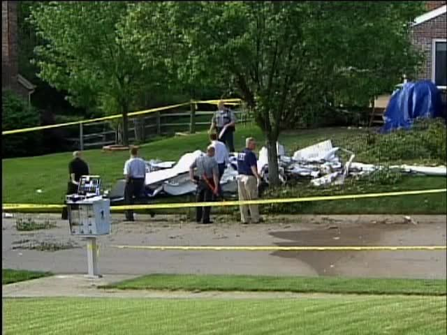 Planes fall onto busy street- suburban front yard after midair collision in 2007