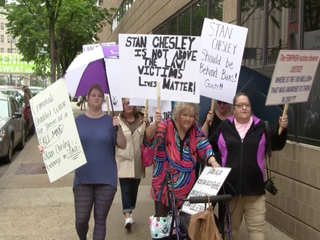Protesters want Stanley Chesley to 'pay up'