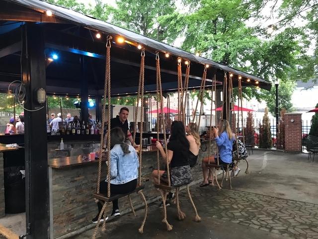 Treehouse Patio Bar Offers Swing Seats