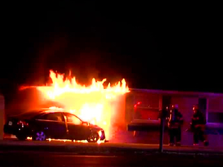 PD: Car bursts into flames after striking home