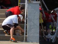 Volunteers paint Army vet's home in Bellevue