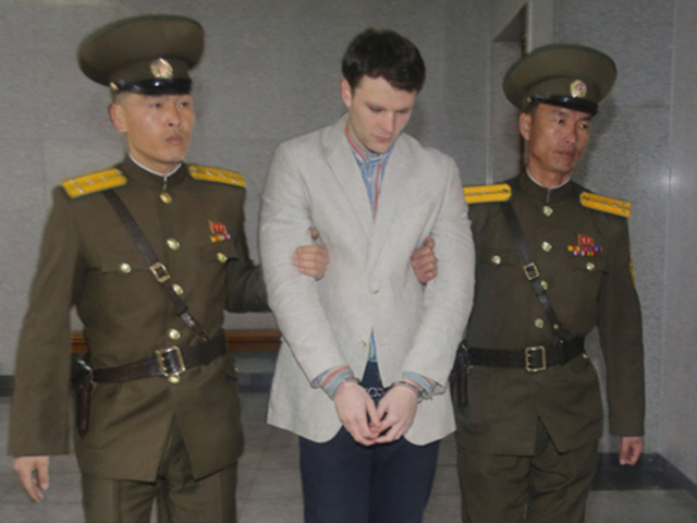 Hundreds mourn student who'd been held in North Korea