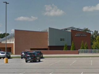 Employee brought loaded gun to Edgewood school