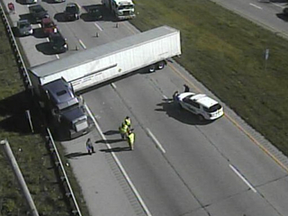 Police revive truck driver who overdosed on I-74