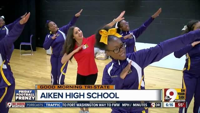 WCPO-s Ben-Gal Jaclyn DeAugustino learns an Aiken High School cheer
