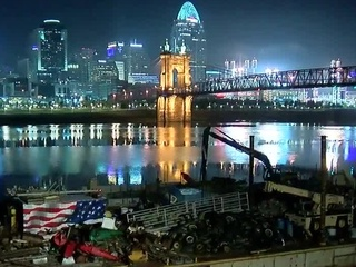Trash barge docks in NKY to help P&G clean river