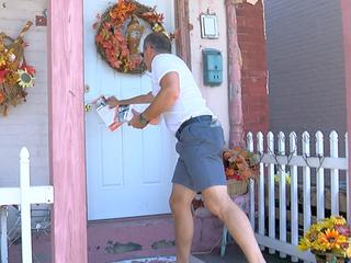 Volunteers distribute heroin addiction helpline