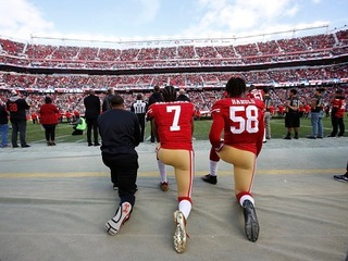 Tell us: Should kneeling players be punished?