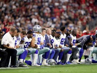 Cowboys, owner kneel before national anthem