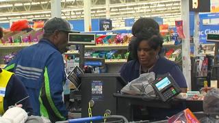 Walmart hero clerk stops scam, saves Christmas