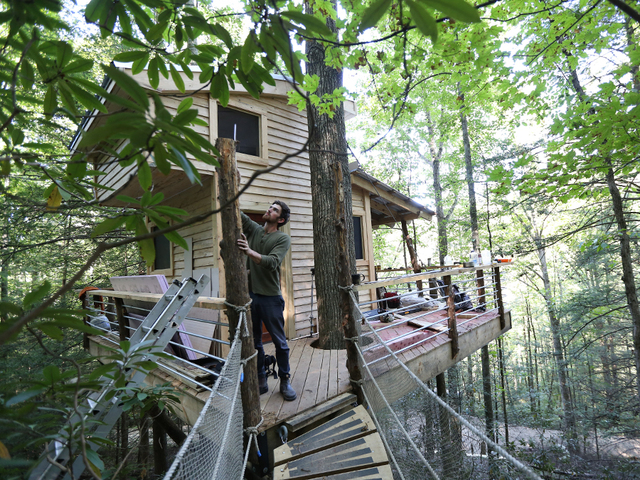 Django Kroner 25 founder of The Canopy Crew puts the final touches on his first tree house rental property in the Red River Gorge. & A view from above: Experience the Red River Gorge from a treeu0027s ...