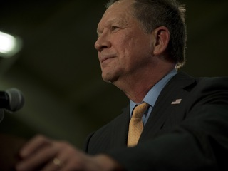Kasich signs order on gun background checks