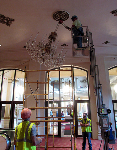 Photos wooden nickel tackles delicate task of removing music hall wooden nickel sets up a pulley system used to lower one of 12 crystal chandeliers it removed from music hall the week of may 30 june 3 aloadofball Choice Image