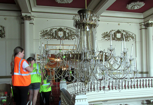 Photos wooden nickel tackles delicate task of removing music hall chandelier parts had to be removed and tagged for re assembly before they were crated and removed from the hall aloadofball Images