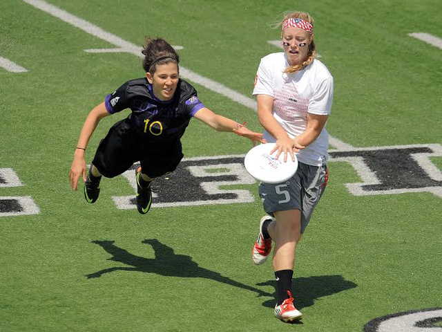 a girl lunging for a disc