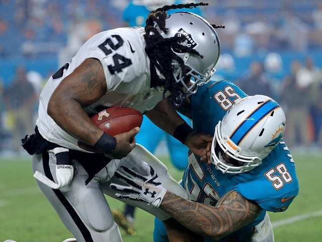 Dolphins linebacker Maualuga cut after overnight battery arrest