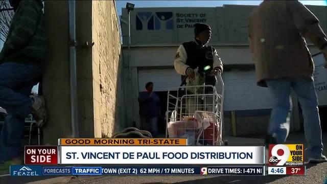 St- Vincent de Paul handing out Thanksgiving meals on Tuesday