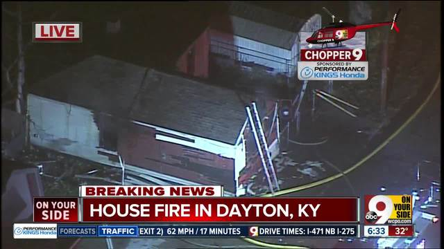 Firefighters say a man drags neighbor out of burning house in Dayton- Ky-