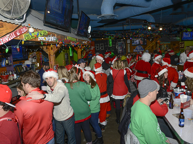 ... Running From Downtown To Over The Rhine To Mount Adams, Drew A Crowd Of  Santas Spreading Holiday Cheer On Dec. 9, 2017. The Scene Inside The Tin  Roof.