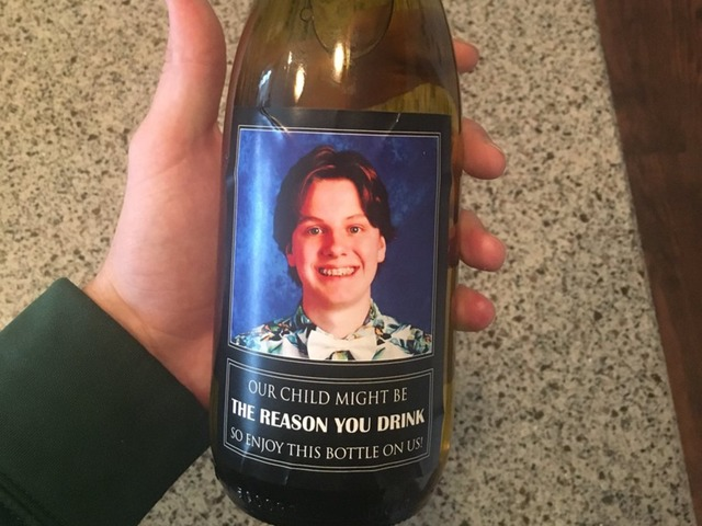 Parents give teacher wine bottles with son's face on label