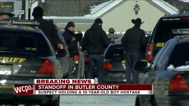 Man holding boy hostage close to Cincinnati surrenders, boy protected