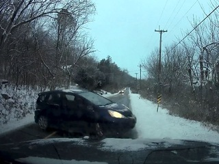 Dashcam catches car sliding into NKY police