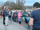 Group holds vigil for school shooting victims