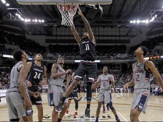 No. 11 Cincy rebounds, beats UConn 77-52