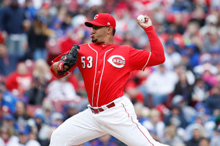 PHOTOS: Reds beat Cubs 1-0 for their 1st win