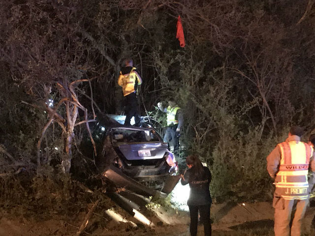 Two crashed cars wind up in woods off I-275