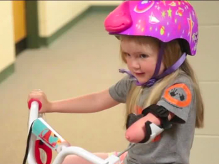 Pizza leads to prosthetic arm for young girl