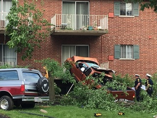 1 dead after truck goes airborne into balcony