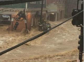 Flash flood surges through Maryland community