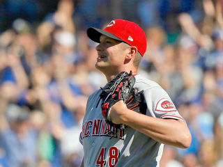 Reds' bullpen blows big lead in loss to Cubs