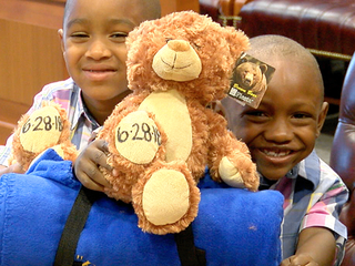 Woman adopts former foster sons