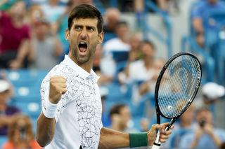 Federer, Djokovic outlast rain, reach W&S semis