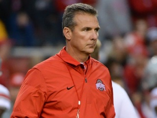 Urban Meyer says he'll be back at OSU next year