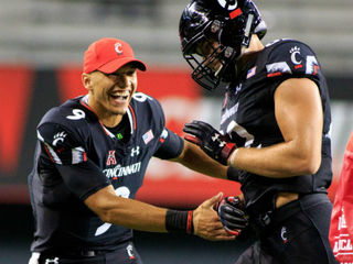 Ridder proves he's right QB for UC in 63-7 rout